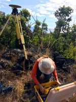 Global Positioning System (GPS) is used to track deformation (ground surface changes) on Hawaiian volcanoes. Here, an HVO geophysicist completes the final setup on a GPS instrument on Kīlauea so that it can begin collecting data on the volcano's lower East Rift Zone. USGS photo by L. DeSmither. Photo taken Tuesday, February 19, 2019 courtesy of U.S. Geological Survey