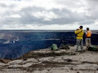 Kīlauea has been relatively quiet since September 2018. However, Hawaiian Volcano Observatory scientists continue to monitor the volcano for any signs of change and to learn as much as they can from the dramatic events of this past summer. Here, HVO scientists scout possible locations for a webcam to provide additional views into the enlarged crater within Kīlauea's summit caldera. USGS photo by M. Zoeller. Photo taken Tuesday, February 19, 2019 courtesy of U.S. Geological Survey
