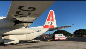 A Coast Guard HC-130 Hercules aircrew delivers a 35-year-old man suffering from sepsis in Hilo, Hawaii, Feb. 20, 2019. The aircrew worked jointly with the Hawaii Disaster Medical Assist Team to medevac the man quickly to a higher level of medical care. (U.S. Coast Guard photo by Lt. Eric Ferree)