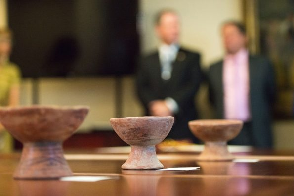 Dozens of Colombian artifacts recovered by the FBI were repatriated during a ceremony in October 2018 at the Colombian Embassy in Washington, D.C. Seen in the background are FBI Special Agent Max Marker and Colombian Ambassador H.E. Francisco Santos. FBI Photo