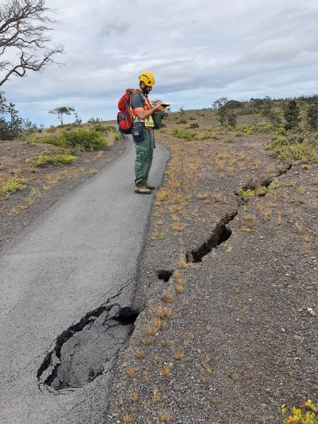 Fractures and sinkholes on Crater Rim Trail being assessed. NPS Photo