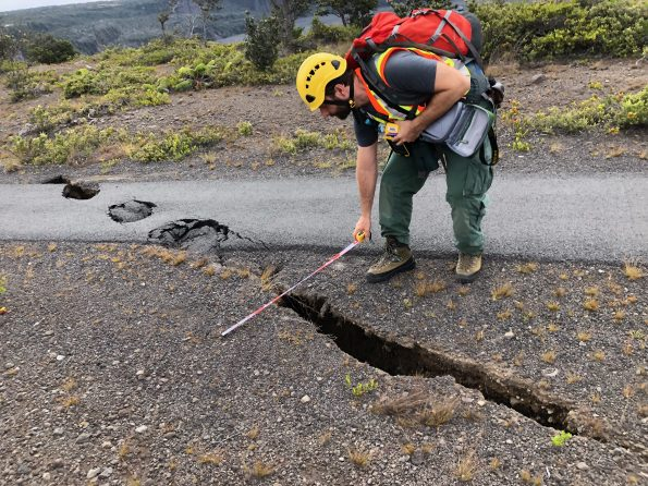 Measuring cracks and-sinkholes on Crater Rim Trail. NPS Photo