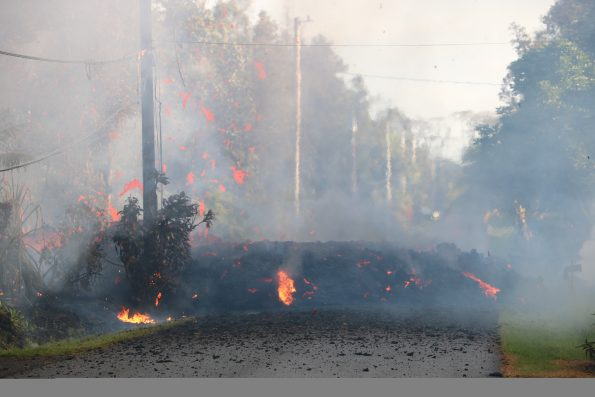 The start of fissure 3 during Kīlauea's lower East Rift Zone eruption. Lava erupting to the surface cut across Kaupili Street around 7:00 a.m. on May 4, 2018. USGS photo by M. Patrick.
