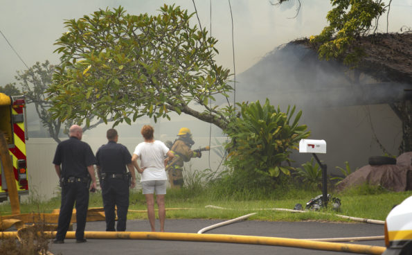 A firefighters hoses down a structure Fire at 545 Ocean View Drive Friday, September 20, 2019. Hawaii 24/7 Photo by Baron Sekiya