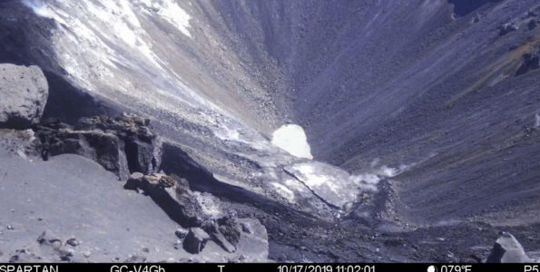 This image is from a temporary monitoring camera on the west rim of Kilauea Caldera. The camera is looking E towards the bottom of the newly enlarged Halemaʻumaʻu crater. The crater from left to right (roughly NNE to SSW) is approximately 1 km (0.6 mi) across. The depth of the crater in the visible image from the rim is several hundred meters.