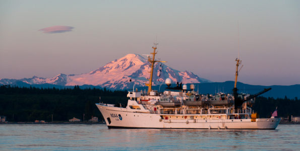 The National Oceanic and Atmospheric Administration Ship Rainier is backdropped by Mount Baker, an active Cascade Range stratovolcano, in Washington. In September 2019, the Rainier conducted a bathymetric survey alongHawaiʻiIsland's Puna coast, where lava entered the ocean duringKīlaueaVolcano's 2018 eruption.Photo courtesy of NOAA.